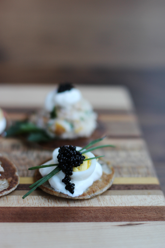 blinis with caviar and quail egg