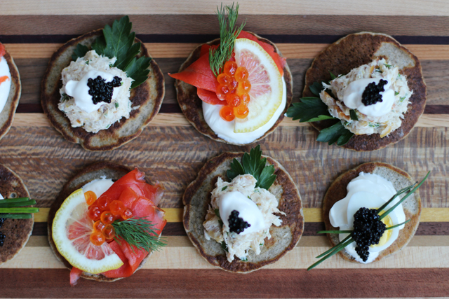 For the smoked salmon blinis, dollop creme fraiche on a blini and top ...