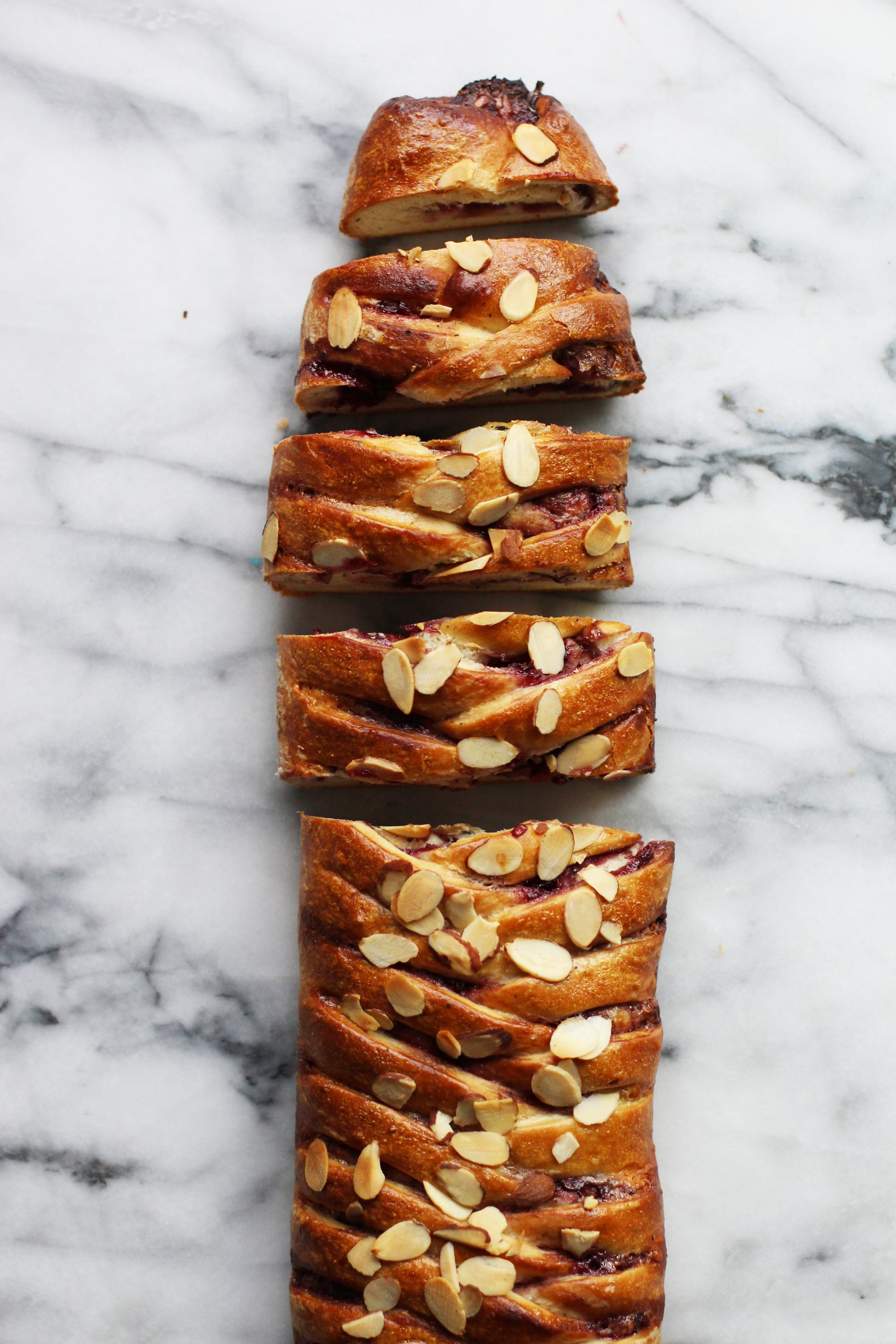 Sliced braided cardamom coffee bread