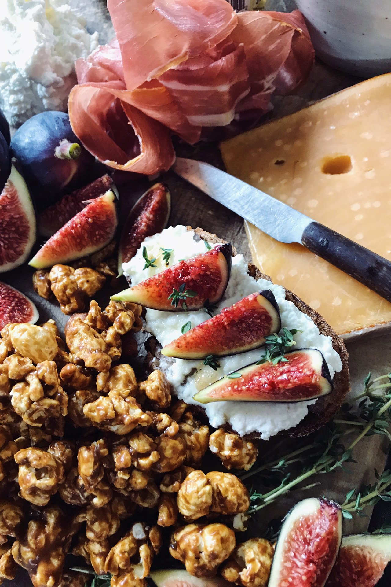Cheese platter with almonds and figs.